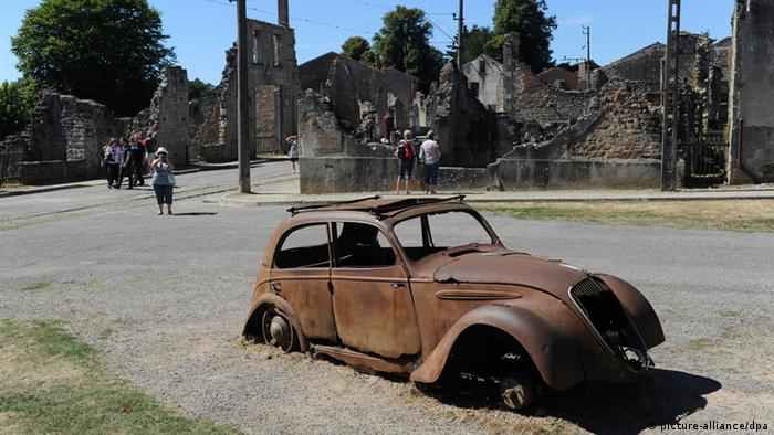 The ruined village, and a burned-out car from 1944