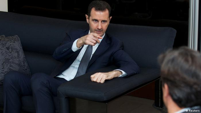 Syria's president Bashar al-Assad gestures during an interview with French daily Le Figaro in Damascus (photo via Reuters)