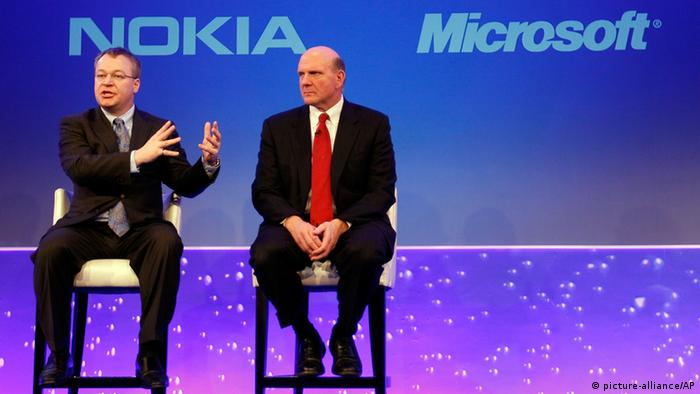 Photo shows Stephen Elop CEO of Nokia, left, with CEO of Microsoft Steve Ballmer Photo/Alastair Grant, File