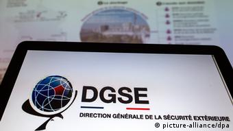 epa03776108 The logo of France's intelligence service, the DGSE (Direction Generale de la Securite Exterieure) displayed in front of a graphic from the French daily newspaper Le Monde depicting the agency's methods for intercepting and collecting data, in Paris, France, 05 July 2013. France's daily newspaper Le Monde revealed that France's DGSE intelligence service is running a vast scale computer and telephone data interception and collection programme, similar to the controversial Prism programme used by the National Security Agency (NSA) in the US - an operation running 'outside the law and beyond proper supervision' according to the newspaper. EPA/IAN LANGSDON