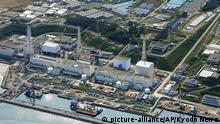This aerial photo taken on Aug. 31, 2013, shows the Fukushima Dai-ichi nuclear plant at Okuma in Fukushima prefecture, northern Japan. Japan will fund some of the costly, long-term projects to control the worrisome and growing leaks of contaminated water at the crippled Fukushima nuclear plant. Public funding is part of several measures the government adopted Tuesday, Sept. 3, 2013. (AP Photo/Kyodo News) JAPAN OUT, MANDATORY CREDIT