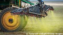 Herbicide is sprayed on a soybean field in the Cerrado plains near Campo verde, Mato Grosso state, western Brazil on January 30, 2011. In neighboring Pantanal area, a sanctuary of biodiversity, is presently at risk because of the intensive culture of soybean and the deforestation, scientists said. AFF PHOTO/Yasuyoshi CHIBA (Photo credit should read YASUYOSHI CHIBA/AFP/Getty Images)
