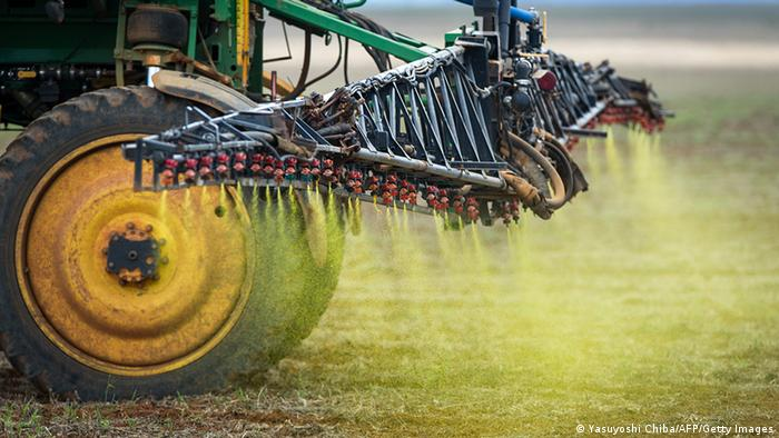 Photo: A tractor sprays herbicides on a field (Photo credit: YASUYOSHI CHIBA/AFP/Getty Images)