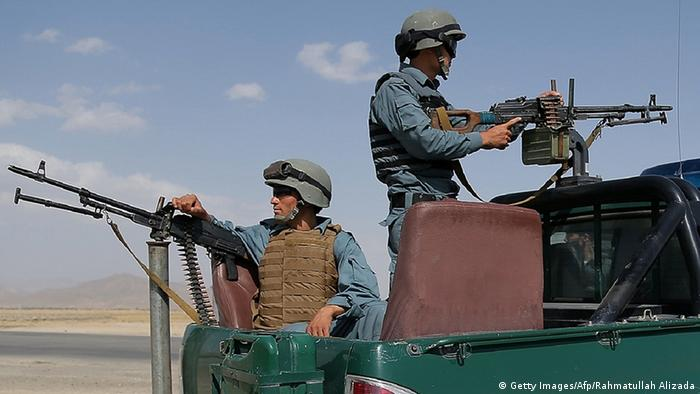 Afghan policemen keep watch at a checkpoint where Taliban militants have kidnapped a female Afghan member of parliament, in Ghazni on August 14, 2013 (Photo: RAHMATULLAH ALIZADA/AFP/Getty Images)