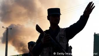 A silhouette of an Afghan secret policeman