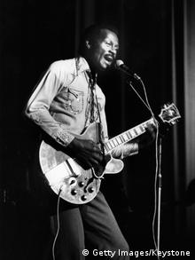 6th May 1977: Hugely influential singer, songwriter and guitarist Chuck Berry, (Charles Edward Anderson), performing on stage with his guitar at the Birmingham Odeon in England. (Photo by Keystone/Getty Images)