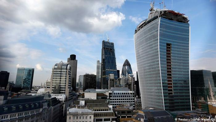 The Walkie Talkie tower (R) is seen in central London September 3, 2013. The developers of a London skyscraper that reflects sunlight at such intense levels that it warped panels and melted mirrors on a parked car will not need to break the bank to fix the problem, a project source told Reuters. REUTERS/Stefan Wermuth (BRITAIN - Tags: BUSINESS CITYSCAPE REAL ESTATE ENVIRONMENT)