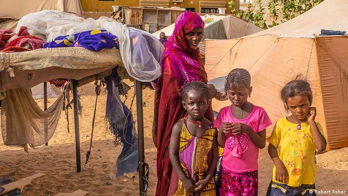 Women with three children in front of tents in Mauritania