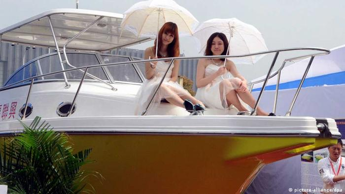 Chinese models pose on a yacht