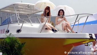 Models pose on a yacht during the 2012 China (Shanghai) International Boat Show in Shanghai, China, 19 April 2012. China (Shanghai) International Boat Show is the most comprehensive and longest established boat and yacht exhibition in China, covering displays of its whole industry chain since its launch in 1996. CIBS has progressively established itself as the endorser and facilitator for yachting culture in 16 years. The show of this year will be held at the Shanghai Expo Exhibition & Convention Center from 19 April to 22 April. (eingest. sc)