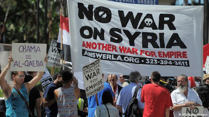 People demonstrate against a US-led strike on Syria in downtown Los Angeles on August 31, 2013. (Photo: JOE KLAMAR/AFP/Getty Images)