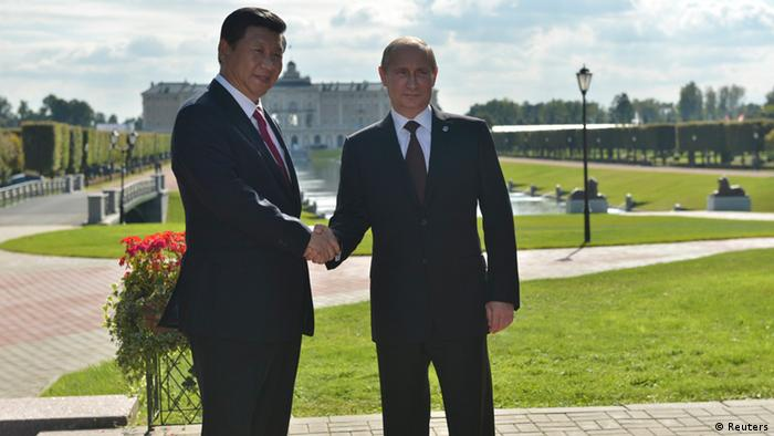 Russia's President Vladimir Putin (R) shakes hands with his Chinese counterpart Xi Jinping before a BRICS leaders' meeting at the G20 Summit in Strelna near St. Petersburg September 5, 2013. REUTERS/Alexei Kudenko/RIA Novosti/Pool (RUSSIA - Tags: POLITICS BUSINESS) ATTENTION EDITORS - THIS IMAGE HAS BEEN SUPPLIED BY A THIRD PARTY. IT IS DISTRIBUTED, EXACTLY AS RECEIVED BY REUTERS, AS A SERVICE TO CLIENTS