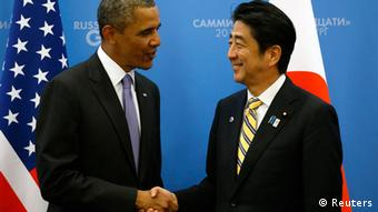 U.S. President Barack Obama (L) shakes hands with Japanese Prime Minister Shinzo Abe at the G20 Summit in St. Petersburg, Russia September 5, 2013.