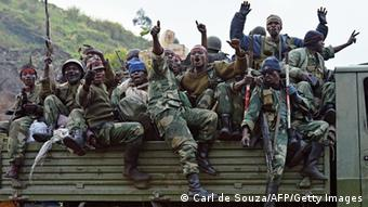 Democratic Republic of Congo (FARDC) soldiers celebrate near Kibati, near Goma on September 4, 2013. M23 army mutineers, whose 16-month rebellion had seen them occupying Kibati for over a year, have retreated from their positions in the hills around Goma in the face of an offensive by the military and a new United Nations combat force. AFP PHOTO / CARL DE SOUZA (Photo credit should read CARL DE SOUZA/AFP/Getty Images)