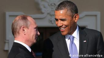 epa03851992 Russian President Vladimir Putin (L) and US President Barack Obama (R) exchange smiles as the latter arrives for the first session of G20 summit in St. Petersburg, Russia, 05 September 2013. Top item on the agenda is thecrisis in Syria where both the US and Russia hold widely opposing views. EPA/ANATOLY MALTSEV