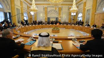 SAINT PETERSBURG - SEPTEMBER 05: In this handout image provided by Host Photo Agency, heads of state and international organizations attend the first working meeting of the G20 summit on September 5, 2013 in St. Petersburg, Russia. The G20 summit is expected to be dominated by the issue of military action in Syria while issues surrounding the global economy, including tax avoidance by multinationals, will also be discussed duing the two-day summit. (Photo by Ramil Sitdikov/Host Photo Agency via Getty Images)