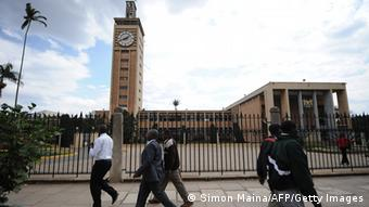 Kenyans walk past the parliament building in Nairobi on September 5, 2013. Kenyan lawmakers backed a motion to pull out of the International Criminal Court, an angry snub to The Hague-based tribunal ahead of next week's trial of Vice President William Ruto. The motion to suspend any links, cooperation and assistance to the court was overwhelming approved by the National Assembly. AFP PHOTO / SIMON MAINA (Photo credit should read SIMON MAINA/AFP/Getty Images)