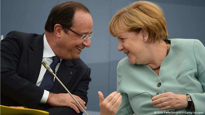 Frances President Francois Hollande (L) smiles while talking to Germanys Chancellor Angela Merkel as they attend a meeting with Business 20 and Labour 20 representatives during the G20 summit on September 6, 2013 in Saint Petersburg. AFP PHOTO / ERIC FEFERBERG (Photo credit should read ERIC FEFERBERG/AFP/Getty Images)