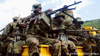 Soldiers of the M23 rebel movement hold weapons aboard a vehicle in Sake near Goma, the Democratic Republic of the Congo. (Photo by Takeshi Kuno) (Kyodo)