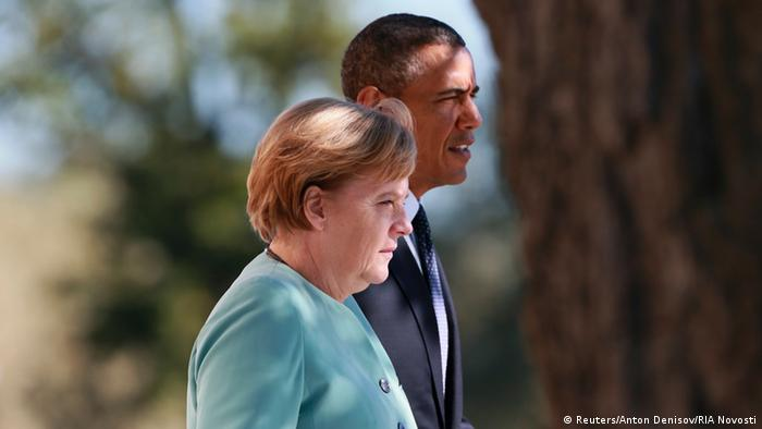 Angela Merkel (L) and U.S. President Barack Obama walk together during the G20 summit in St.Petersburg September 6, 2013.