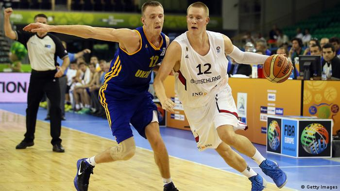 Maxym Korniyenko of Ukraine defends against Germany's Robin Benzing. Germany fell 88-83 to put their knockout round chances in doubt. Photo: Getty Images