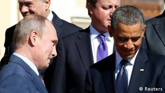 Russian President Vladimir Putin (L) walks past U.S. President Barack Obama (R) during a group photo at the G20 Summit in St. Petersburg September 6, 2013. (Photo: REUTERS/Kevin Lamarque)