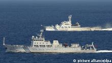 [34090654] Inselstreit zwischen Japan und China ©Kyodo/MAXPPP - 14/09/2012 ; NAHA, Japan - Photo from a Kyodo News aircraft shows the Chinese marine surveillance ship Haijian 51 (front) in Japanese territorial waters near the Japan-controlled Senkaku Islands in the East China Sea on Sept. 14, 2012. China also claims the islets and calls them the Diaoyu Islands. At back is a patrol ship of the Japan Coast Guard. (Kyodo)