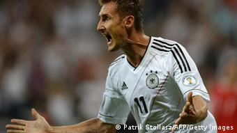 Germany's striker Miroslav Klose celebrates after scoring the 1-0 during the FIFA World Cup 2014 group C qualifying football match of Germany vs Austria on September 6, 2013 in Munich, southern Germany. AFP PHOTO / PATRIK STOLLARZ (Photo credit should read PATRIK STOLLARZ/AFP/Getty Images)