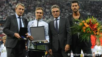Wolfgang Niersbach, president of the German football association DFB (L), and Helmut Sandrock, secretary general of the German football association DFB (3rd from R), honour Germany's Philipp Lahm (2nd from R) and former team captain Michael Ballack prior to the FIFA World Cup 2014 qualification group C soccer match between Germany and Austria at Allianz Arena in Munich, Germany, 06 September 2013. Photo: Andreas Gebert/dpa +++(c) dpa - Bildfunk+++