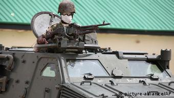A Nigerian soldier inside an armored carrier