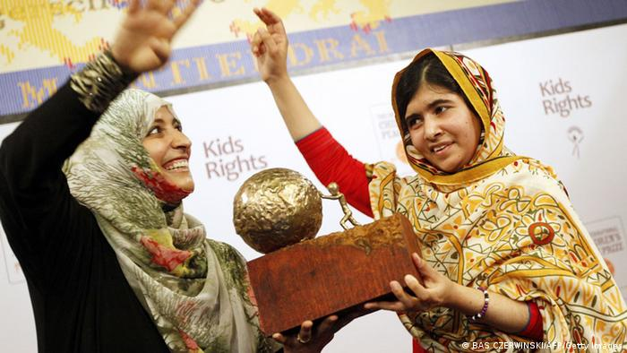 16-year old Malala Yousafzai (R) from Pakistan receives a trophy from Yemeni Civil Rights activist and 2011 Nobel Peace Prize winner Tawakkul Karman after being honored with the International Children's Peace Prize at the Ridderzaal in the Hague, the Netherlands, on September 6, 2013. Malala was attacked by Taliban on October 9, 2012, for advocating girls rights to education and wounded along with two schoolmates. AFP PHOTO / ANP / BAS CZERWINSKI ***Netherlands out*** (Photo credit should read BAS CZERWINSKI/AFP/Getty Images)