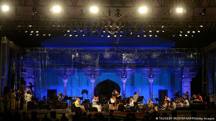 Conductor Zubin Mehta (C) is pictured onstage with musicians during a rehearsal at the venue of the upcoming Ehaas-Kashmir music concert in Srinagar on September 6, 2013. Renowned conductor Zubin Mehta said he wants to bring peace to Indian Kashmir through music, after separatist leaders demanded a controversial concert planned for the disputed region be scrapped. Photo:TAUSEEF MUSTAFA/AFP/Getty Images