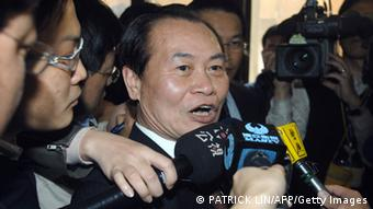 Taiwan's new justice minister, Tseng Yung-fu (C), speaks to reporters after being sworn in at a ceremony in Taipei on March 22, 2010. Tseng replaced Wang Ching-feng, who resigned earlier this month after she attracted a storm of criticism over a vow not to order any executions during her term. Wang's predecessor was also anti-death penalty and Taiwan has not carried out an execution since 2005. AFP PHOTO / PATRICK LIN (Photo credit should read PATRICK LIN/AFP/Getty Images)
