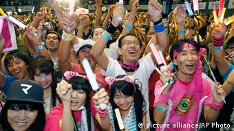 Japanese supporters of the Tokyo Bid 2020 team celebrate in Tokyo early Sunday morning, Sept. 8, 2013, upon learning Tokyo won the bid to host the 2020 Olympics at the IOC voting as they watch a live broadcast from Buenos Aires, Argentina. (Photo: AP Photo/Shizuo Kambayashi) )