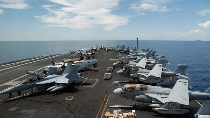 A general view of the aircrafts on the flight deck during a tour of the USS Nimitz aircraft carrier on patrol in the South China Sea in this file photo from May 23, 2013. The Nimitz and four other ships in its strike group moved into the Red Sea early September 1, 2013, U.S. defense officials said, describing the move as prudent planning in case the ships are needed for military action against Syria. REUTERS/Edgar Su/Files (SINGAPORE - Tags: MILITARY MARITIME)