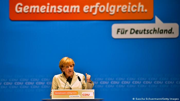 DUSSELDORF, GERMANY - SEPTEMBER 08: German Chancellor and Chairwoman of the German Christian Democrats (CDU) Angela Merkel gives a speech at the first election campaign rally in the final phase of campaigning on September 8, 2013 in Dusseldorf, Germany. Germany is facing federal elections scheduled for September 22 and so far Merkel and the CDU have a strong lead in polls over the opposition. (Photo by Sascha Schuermann/Getty Images)