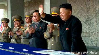 In this image taken from video North Korean leader Kim Jong Un, right, smiles as he waves to spectators and participants of a military parade celebrating the 65th anniversary of the country's founding, Monday, Sept. 9, 2013, in Pyongyang, North Korea. (AP Photo/KRT via AP Video) TV OUT, NORTH KOREA OUT pixel
