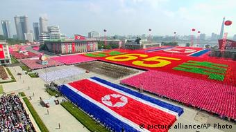In this image taken from video North Korean soldiers and performers participate in a mass military parade to celebrate the 65th anniversary of the country's founding, Monday, Sept. 9, 2013, in Pyongyang, North Korea. (AP Photo/KRT via AP Video)