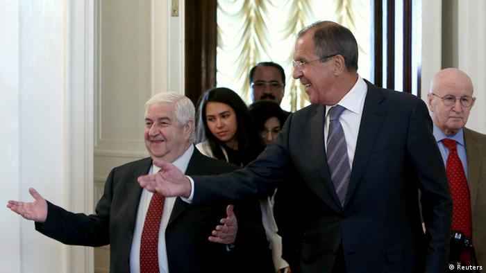 Russia's Foreign Minister Sergei Lavrov (R, front) shows the way to his Syrian counterpart Walid Moualem (L) during a meeting in Moscow. Photo: Reuters.
