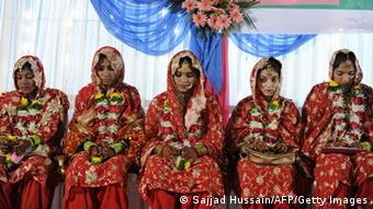 Indian Muslim brides sit during a mass marriage ceremony in Mumbai on June 15, 2009. (Photo: AFP)