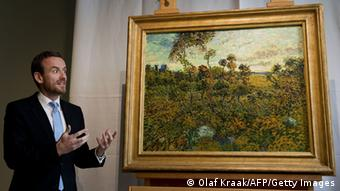 Director of the Van Gogh Museum in Amsterdam, Alex Ruger presents a painting by Vincent van Gogh, entitled 'Sunset at Montmajour' and painted in 1888, on September 9, 2013, in Amsterdam. 'Sunset at Montmajour,' a large oil landscape, was unveiled to applause by the museum's director Axel Rueger as a 'unique experience that has not happened in the history of the Van Gogh Museum.' It had been lying for years in the attic of a Norwegian collector who thought the painting was a fraud, after buying it in 1908. AFP PHOTO / ANP / OLAF KRAAK ***netherlands out*** (Photo credit should read OLAF KRAAK/AFP/Getty Images)