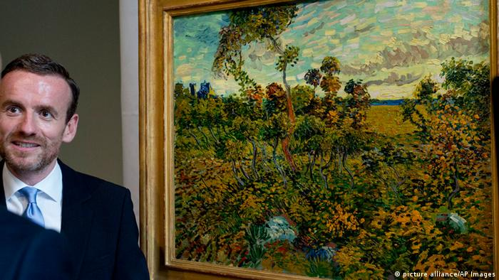 Van Gogh Museum director Axel Ruger, left, displays the newly discovered Sunset at Montmajour painting by Dutch painter Vincent van Gogh. Photo: AP
