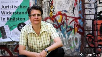 Portrait of Monika Herrmann against a grafitti wall Photo: imago/Caro