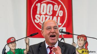 The top-candidate of the left-wing Die Linke party Gregor Gysi speaks during an election campaign rally in Leipzig, August 28, 2013. German voters will take to the polls in a general election on September 22. REUTERS/Thomas Peter (GERMANY - Tags: POLITICS ELECTIONS)