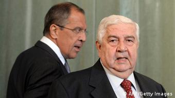 Syrian Foreign Minister Walid Muallem (R) and and his Russian counterpart Sergei Lavrov (L) walk to a press conference on September 9, 2013 following a meeting in Moscow. (Photo credit: YURI KADOBNOV/AFP/Getty Images)