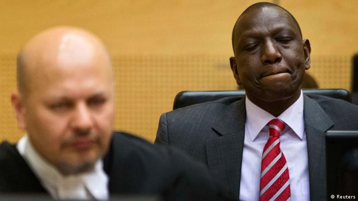 Kenya's Deputy President William Ruto ( R) reacts as he sits in the courtroom before his trial at the International Criminal Court (ICC) in The Hague September 10, 2013. Ruto appeared at the International Criminal Court on Tuesday for the opening of his trial on charges of co-orchestrating a post-election bloodbath five years ago. Ruto and his co-accused, the broadcaster Joshua arap Sang, could face long prison terms if convicted. To the left is defense counsel Karim Khan. REUTERS/Michael Kooren (NETHERLANDS - Tags: ELECTIONS POLITICS CRIME LAW)