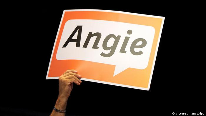 A sign reading Angie and reffering to chancellor Angela Merkel