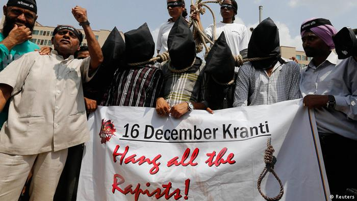 Demonstrators with their heads covered by black cloth take part in a protest outside a court in New Delhi September 10, 2013. Four men were found guilty on Tuesday of the gang rape and murder of a 23-year-old woman in New Delhi last year, according to a defence lawyer in a case that sparked global outrage and protests in India over the lack of safety for women in the world's largest democracy. REUTERS/Adnan Abidi (INDIA - Tags: CRIME LAW CIVIL UNREST)