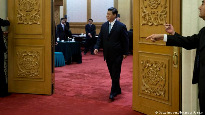 BEIJING, CHINA - JULY 18: Chinese President Xi Jinping walks out of a meeting room to shake hands with Swiss Federal President Ueli Maurer before their meeting at the Great Hall of the People on July 18, 2013 in Beijing, China. (Photo by Alexander F. Yuan - Pool/Getty Images)