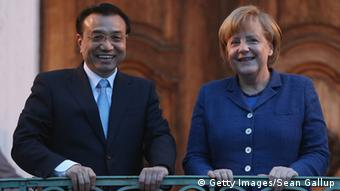 MESEBERG, GERMANY - MAY 26: German Chancellor Angela Merkel and Chinese Prime Minister Li Keqiang stand at the entrance to the Meseberg government guest house upon Mr. Li's arrival there for dinner on May 26, 2013 in Meseberg, Germany. On his first official visit to Germany as prime minister Mr. Li is scheduled to meet with German government officials and business representatives. (Photo by Sean Gallup/Getty Images)
